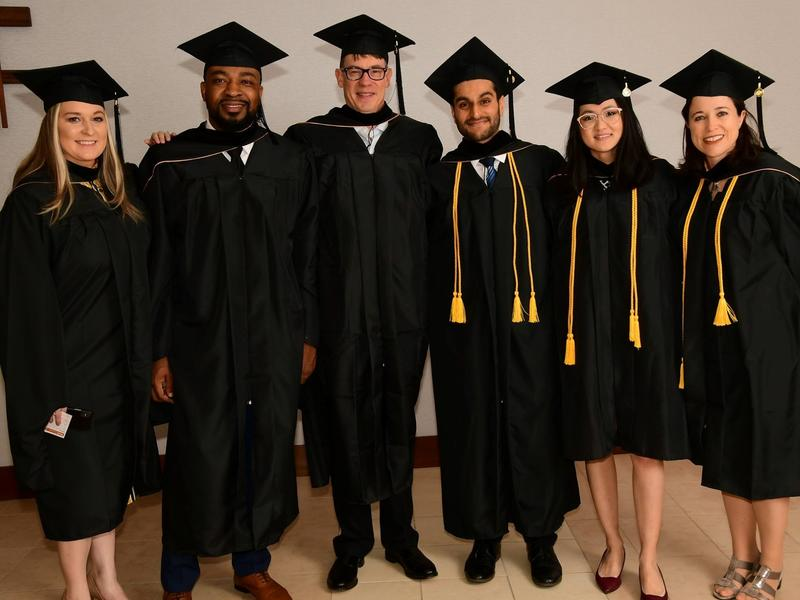 Iowa MBA Graduates Posing