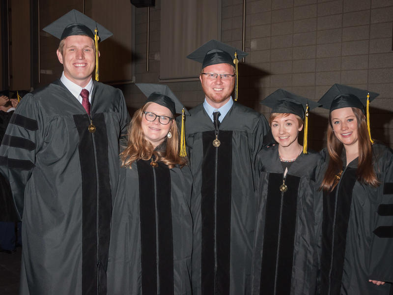 Doctor of Medicine and Masters in Medical Education Graduates Posing